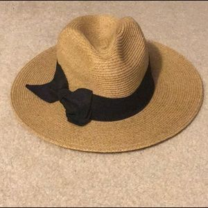 tan hat with black bow around